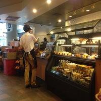 Photo taken at Starbucks by Erica G. on 11/11/2013