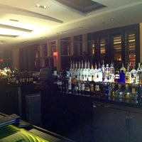 Photo taken at Aura Lounge at Naples Grande by Rozanne M. on 1/31/2014