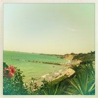 Photo taken at Playa de Fuentebravía by Nattalia G. on 8/21/2013