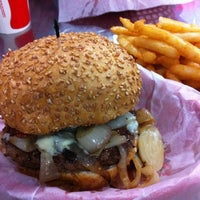 Photo taken at Pearl's Deluxe Burgers by TV Food and Drink on 10/27/2012