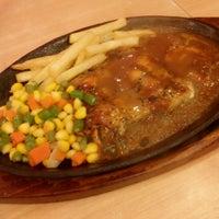 Photo taken at Steak 21 by Yovita P. on 10/25/2014