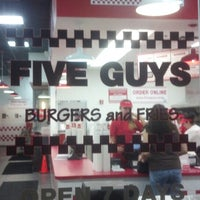 Photo taken at Five Guys by Laura K. on 12/2/2013