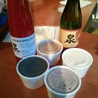 Photo taken at Ontario Spring Water Sake Company by Amy L. on 10/11/2014