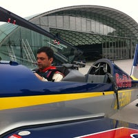 Photo taken at Hangar 8 by Constanza M. on 9/29/2013