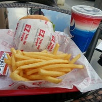 Photo taken at EZ Takeout Burger by Manaf A. on 12/27/2012
