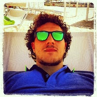Photo taken at Novavita Beach by Stefano N. on 7/31/2014