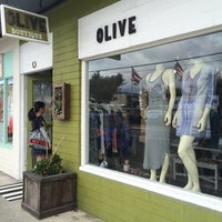 Photo taken at Olive Boutique by Sally B. on 3/23/2014