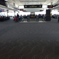 Photo taken at Gate A51 by Christina B. on 3/3/2016