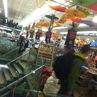 Photo taken at Pearl River Mart by Jonathan V. on 12/8/2012