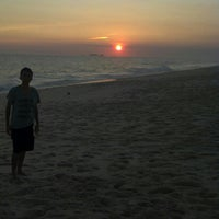 Photo taken at Praia da Barra de Maricá by Rodrigo N. on 12/25/2012