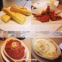 Photo taken at Pizza Hut Bistro by Jen P. on 12/4/2013