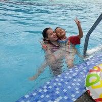 Photo taken at Kolam Renang Mutiara Residence by Puspa Y. on 9/6/2014