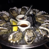 Photo taken at Mayes Oyster House by Tina N. on 11/11/2013