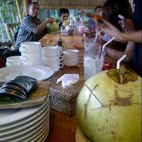 Photo taken at Gubug Makan Segara Bambu by Fanny D. on 12/24/2014