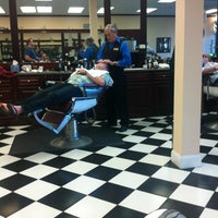 Photo taken at Gino's Classic Barber Shoppe by Cooper G. on 2/25/2012
