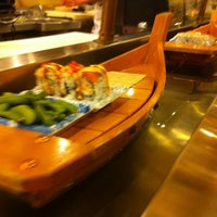 Photo taken at Umi Sushi Boat by Dave C. on 12/8/2012