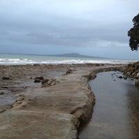 Photo taken at Mairangi Bay Beach by at T. on 10/7/2012