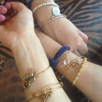 Photo taken at ALEX AND ANI by Reina Q. on 7/2/2013