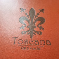 Photo taken at Toscana Cafe & Wine Bar by Jason T. on 5/26/2013