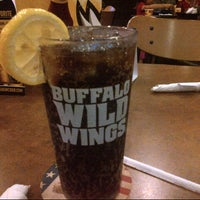 Photo taken at Buffalo Wild Wings by Corinne P. on 5/11/2013