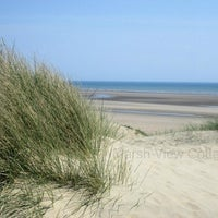 Photo taken at Camber Sands Beach by Sue P. on 11/18/2013
