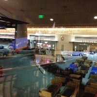 Photo taken at Gate 22 by Emily I. on 12/3/2013