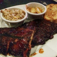 Photo taken at Smokey Bones Bar & Fire Grill by Eric C. on 10/18/2014