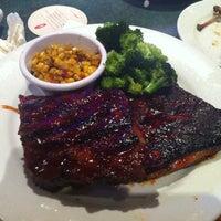 Photo taken at Smokey Bones Bar & Fire Grill by Eric C. on 10/15/2012