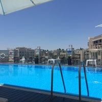 Photo taken at Dan Panorama Hotel (דן פנורמה) by Laëtitia J. on 7/10/2015