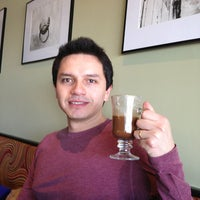Photo taken at Paris Cafe by Viviana B. on 3/28/2013
