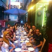 Photo taken at Güney Kebap by Ahmet S. on 7/23/2014