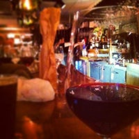 Photo taken at Brown Dog Café & Wine Bar by Bee D. on 12/27/2013