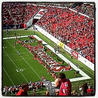 Photo taken at Raymond James Stadium by Erin W. on 11/25/2012
