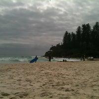 Photo taken at Coolangatta Beach by Juliana G. on 3/30/2013