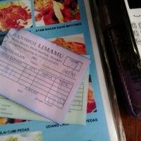 Photo taken at Foodspot 5mu (LimaMu) by Aulia N. on 3/2/2014