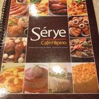 Photo taken at Sérye Café Filipino by Fedelyn D. on 7/16/2014