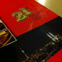 Photo taken at 21st Century Cafe by Carol C. on 2/28/2013