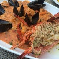 Photo taken at Tortino Restaurant by Kumi K. on 8/25/2014