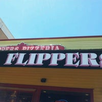 Photo taken at Flippers Pizzeria by Cris M. on 4/23/2012