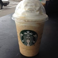 Photo taken at Starbucks by Marina C. on 6/3/2012