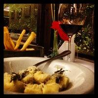 Photo taken at Aguzzo Caffè e Cucina by Caroline D. on 6/22/2012