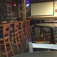 Photo taken at The Lion's Den Pub and Grill by Bobby G. on 3/8/2013