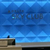 Photo taken at Delta Sky Club by Cynarah A. on 10/19/2012