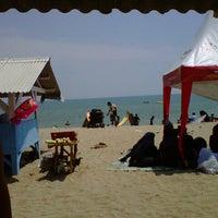 Photo taken at Pantai Sambolo by Adhityo R. on 8/26/2012