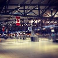 Photo taken at Ottawa Macdonald-Cartier International Airport (YOW) by Amanda L. on 7/8/2013