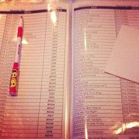 Photo taken at Karaoke Hut Sports Bar & Grill by Kaimana on 6/9/2013