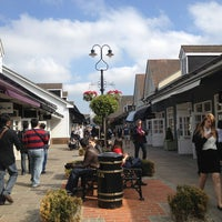 Photo taken at Bicester Village by Chuan P. on 4/25/2013