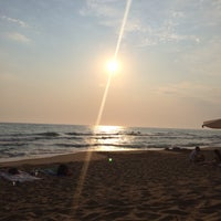 Photo taken at Tholo Beach by Ouranique Z. on 7/23/2015