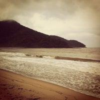 Photo taken at Praia de Boiçucanga by Leonardo C. on 3/18/2013