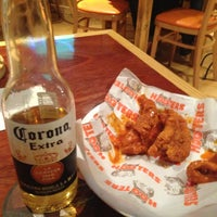 Photo taken at Hooters by Oscar V. on 4/13/2013